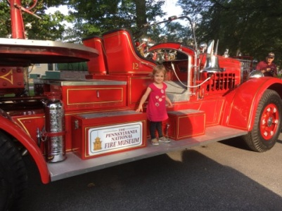 Kid on Antique Fire Truck