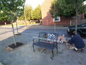 installing the memorial bench at the Broad Street Market